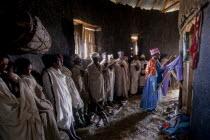 Ethiopia, service inside rural mud built rural Christian church.
