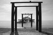 England, East Sussex, Brighton, ruins of the burnt out West Pier fallen into the sea.