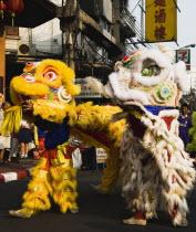 Thailand, Bangkok, Dragon dance Chinese New Year show.