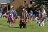 Canada, Alberta, Waterton Lakes National Park, Pow Wow at the Blackfoot Arts & Heritage Festival to celebrate Parks Canada's centennial, Head dancers Jenny Yellow Horn and Aryson Black Plume centre in...