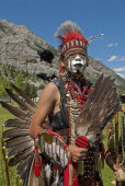 Canada, Alberta, Waterton Lakes National Park, Blackfoot head dancer Aryson Black Plume in full regalia and face paint at the Blackfoot Arts & Heritage Festival Pow Wow organized by Parks Canada and t...