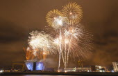 Ireland, North, Belfast, Titanic Quarter, Visitor centre designed by Civic Arts & Eric R Kuhne, illuminated during opening fireworks and projection display.