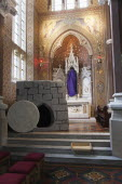 Ireland, North, Belfast, Falls Road, Clonard Monastery interior decorated for Good Friday with statues draped in purple cloth.