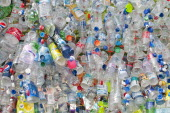 Environment, Recycling, Plastic bottles attached to a wire fence at the WOMAD festival, to highlight the need to recycle non-sustaninable materials.