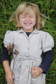 Kids, Outdoor, 5 year old Eva lying in the grass.