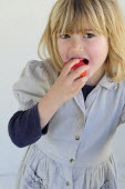 Kids, Eating, Fruit, 5 year old Eva eating first strawberries of the year in February.
