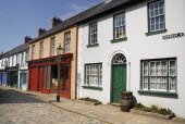 Ireland, County Tyrone, Omagh, Ulster American Folk Park, 19th century street with Victorian shopfronts.