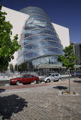Ireland, County Dublin, Dublin City, the Convention Centre building, view of the facade with tree in foreground.