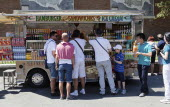 Italy, Lazio, Rome, Tourists at a fast food van near the Colosseum