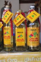 Mexico, Oaxaca, Mezcal bottles.