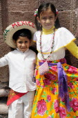 Mexico, Bajio, San Miguel de Allende, Two young children dressed for Independence Day celebrations.