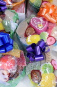 Mexico, Puebla, Colourful sweets wrapped and tied with brightly coloured ribbon.