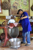 Mexico, Oaxaca, Making chocolate at Mayordomo chocolate shop.