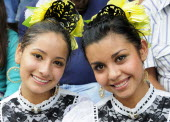 Mexico, Jalisco, Guadalajara, Portrait of two young women Jalisco folkloric dancers.