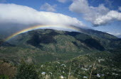 West Indies, Jamaica, Blue Mountains landscape with rainbow and drifts of cloud.