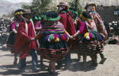 Peru, Cusco, Vilcanota Mountains, Tinqui, villagers in traditional costume dancing during wedding celebrations