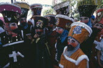 Mexico, Morelos, Cuernavaca, La Fiesta de la Asoncion de Maria, masked group outside during festival.