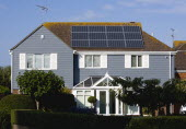 Architecture, Alternative Energy, Electricity, Solar photovoltaic roof panels on detached house for electricity conversion.