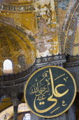 Turkey, Istanbul, Sultanahmet, Haghia Sophia Christian murals and Muslim iconography in calligraphic roundels together in the domed interior.