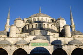 Turkey, Istanbul, Sultanahmet Camii, The Blue Mosque domes seen from the Courtyard with Arabic text from the Koran.