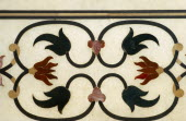 India, Uttar Pradesh, Agra, Taj Mahal, detail of border with semi-precious stones inlaid into marble a technique known as pietra dura or parchin kari.