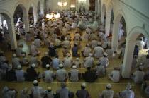 Sri Lanka, Negombo, men at prayer inside mosque.