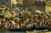 India, Uttar Pradesh, Varanasi, pilgrims gathered on the ghats to bathe in the waters of the river Ganges.