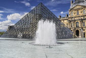 France, Ile de France, Paris, Louvre Museum and glass pyramid.