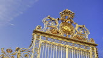 France, Ile de France, Versailles golden entrance gate against blue sky.