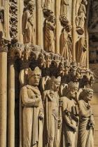 France, Ile de France, Paris, Notre Dame cathedral, detail of carvings around the entrance.