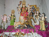 Bangladesh, Dhaka, Durga Puja festival with Durga surrounded by deities and offerings before the altar.
