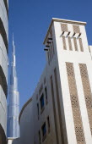 United Arab Emirates, Dubai, Traditional Wind Tower design in front of Burj Khalifa tower.