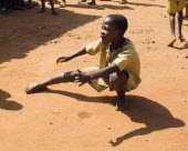 Burundi, Cibitoke Province, Buganda Commune, Ruhagurika Primary School boys playing marbles during their playtime outside Ruhagurika Catch-Up Class. Catch up classes were established by Concern Worldw...