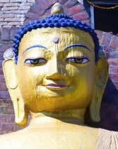 Nepal, Kathmandu, Beautiful golden Buddha head statue at theSwayambunath Monkey Temple.