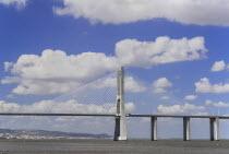 Portugal, Estremadura, Lisbon, Vasco da Gama suspension bridge over the river Tejo seen from Parc das Nacoes.