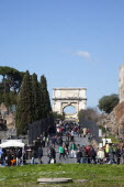 Italy, Lazio, Rome, tourists walking up Via Sacra toward the Arch of Titus on Velian Hill.