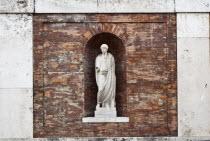 Italy, Lazio, Rome, Niche statue in the walls beneath Piazza del Quirinale.