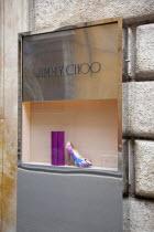 Italy, Lazio, Rome, Via del Condotti, Jimmy Choos display window with shoe and handbag,