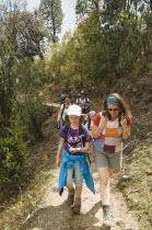 Nepal, Pokhara. Western family with children trekking in Nepali Himalayan hills near Pokhara.
