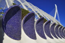 Spain, Valencia Province, Valencia, La Ciudad de las Artes y las Ciencias, City of Arts and Sciences, Arches of the Umbracle sculpture garden with El Pont de l'Assut de l'Or bridge in the background.
