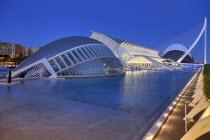 Spain, Valencia Province, Valencia, La Ciudad de las Artes y las Ciencias, City of Arts and Sciences, Overall vista of the complex of buildings at dusk.
