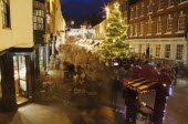 England, Hampshire, Winchester, High street decorated with Christmas tree and decorations, seen from the Buttercross.