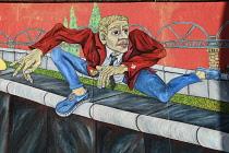 Germany, Berlin, The East Side Gallery, a 1.3  km long section of the Berlin Wall,  'The Wall Jumper' by Gabriel Heimler.