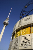 Germany, Berlin, Weltzeituhr also known as the World Clock in Alexanderplatz with the Fernsehturm Berlin's TV Tower in the background.