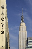 USA, New York, Empire State Building from 34th Street with Macys sign.