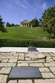 USA, Washington DC, Arlington National Cemetery, Grave of President JF Kennedy with Arlington House in background.