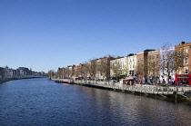 Ireland, Dublin, View along the River Liffey toward the Ha'penny bridge.