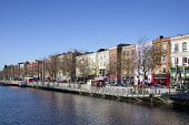 Ireland, Dublin, View along the River Liffey with colourful buildings on the northside..