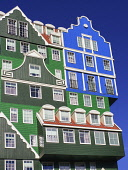 Netherlands, Noord Holland, Zaandam, Angular view of a section of the Inntel Hotel whose construction design is based on the  traditional house facades of the Zaan Region and featuring The Blue House...