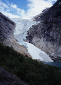 Norway, Sogn og Fjordane, Jostedalsbreen , Briksdalsbreen  one of several glacial tongues extending from the Jostedalsbreen glacier with meltwater lake and densely wooded area in foreground.